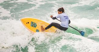 Nicole Pacelli from Brazil riding the waves in the women's SUP surfing competition at the Lima 2019 Games, in Punta Rocas