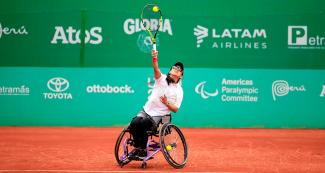 Carolina Moreno from Peru hits the ball in the wheelchair tennis match against Emmy Kaiser from the  USA at the Lawn Tennis Club