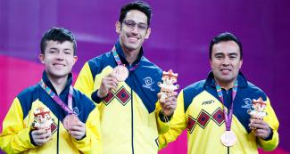 Alvaro Puerto, Diego Jimenez and Julian Chinchilla from Colombia showing their medals on the podium after Lima 2019 Para table tennis competition at the National Sports Village - VIDENA
