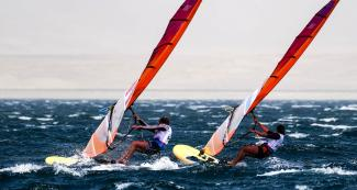 Celia Tejerina of Argentina and María Bazo of Peru compete for medals in the Lima 2019 women's windsurf at Paracas Bay
