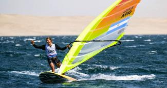 Bautista Saubidet of Argentina celebrates gold in the Lima 2019 men's windsurf event at Paracas Bay.