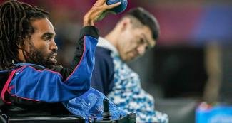 Omar Hayward from Bermuda competes against an Argentine Para athlete in boccia BC1 at the Villa El Salvador Sports Center.