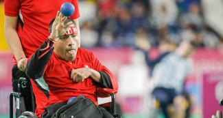 The Peruvian Raymundo Caño gets ready to throw the ball during the Lima 2019 individual boccia BC1 match against the Brazilian Guilherme Moraes at Villa El Salvador Sports Center