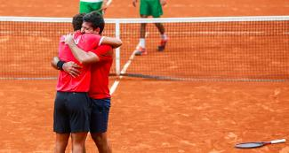 The Peruvian tennis players Juan Pablo Varillas and Sergio Galdos celebrating their victory against Bolivia in doubles at the Lawn Tennis Club.