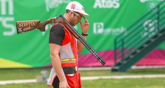 Peruvian Nicolás Pacheco carrying his shotgun on the shoulder at the men's skeet competition at Las Palmas Air Base, Lima 2019 Games