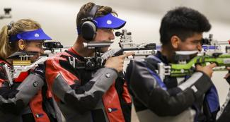 Minden Miles from the US and Luis Mendoza and Lucas Kzeniesky from Puerto Rico, getting ready to shoot in the 10m mixed air rifle Lima 2019 Games competition at Las Palmas Air Base