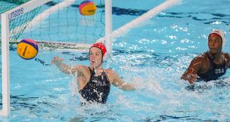 USA's Kiley Neushul and Ashleigh Johnson competing against Peru in Lima 2019 water polo competition at the Villa Maria del Triunfo Sports Center.