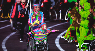 A man and a little girl in a wheelchair were the smiling placard bearers who escorted the Peruvian Para athletes delegation during the Lima 2019 Parapan American Games Opening Ceremony at the National Stadium.