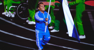 Salvadoran Para athlete Herbert Aceituno proudly walks with his country's flag at the Lima 2019 Parapan American Games Opening Ceremony at the National Stadium.
