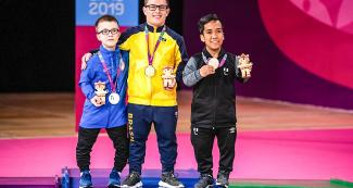 Brazilian Tavares, American Miles Krajewski and Peruvian Hector Salva with the gold, silver and bronze medals in men's Para badminton SS6 at Lima 2019, at the Villa El Salvador Sports Center.