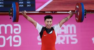 Peruvian Santiago Villegas competes in the men's 73 kg weightlifting competition held at the Chorrillos Military School at Lima 2019.