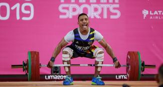 Venezuelan Julio Mayora competes in the men's 73 kg weightlifting event at the Chorrillos Military School at Lima 2019.