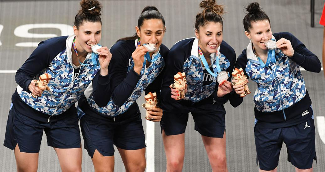 Argentinian players Victoria Llorente, Andrea Boquete, Melissa Gretter and Natacha Pérez perform poses with the silver medals in 3x3 women's basketball.