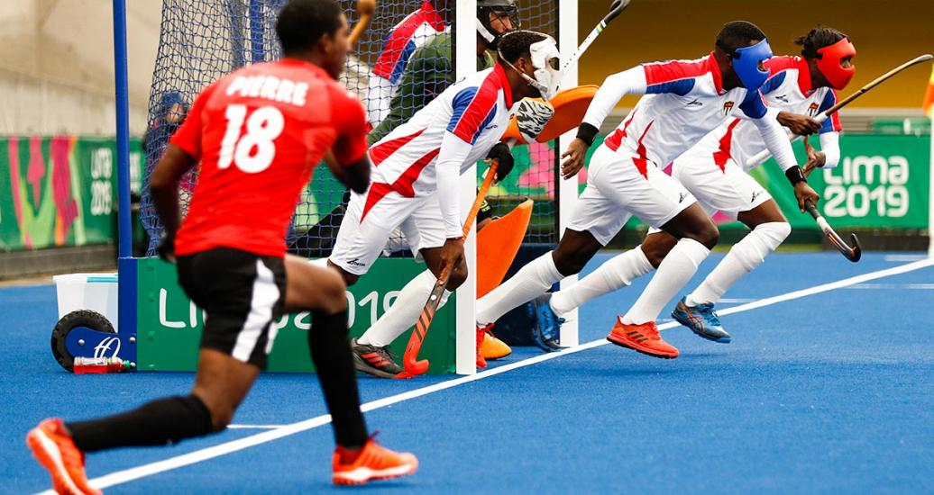 Cuban hockey players defend a short corner against Trinidad and Tobago at Lima 2019.