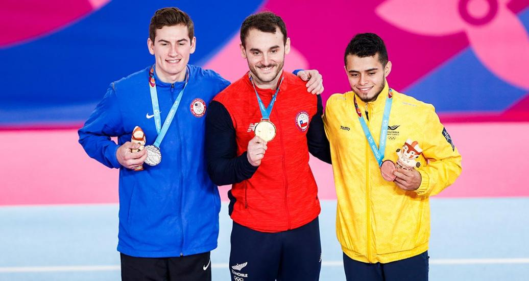 American Robert Neff (silver), Chilean Tomas Gonzalez (gold), and Colombian Andres Martinez (bronze) in the men's artistic gymnastics podium at the Villa El Salvador Sports Center