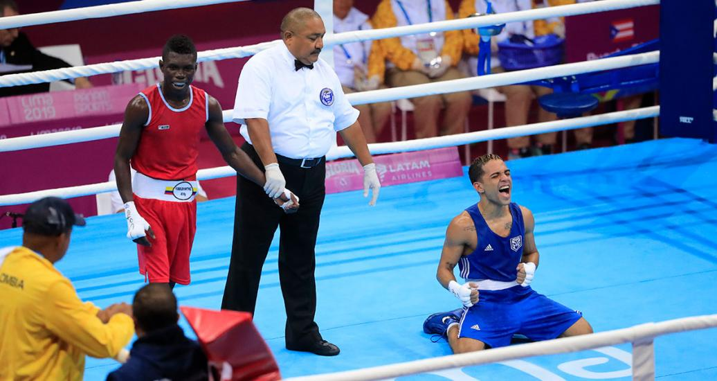 Boxer Oscar Collazo from Puerto Rico celebrates after beating his opponent Yuberjen Martinez from Colombia in the men's flyweight category at the Callao Regional Sports Village