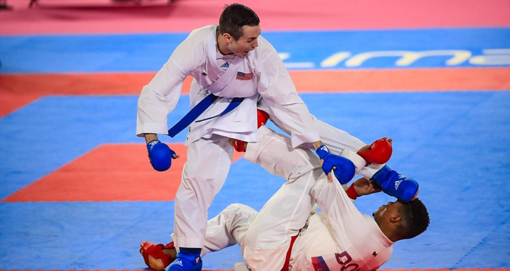 USA's Thomas Scott performs a move on his opponent, Anderson Soriano from the Dominican Republic at the Lima 2019 Pan American Games, held at the Villa El Salvador Sports Center.