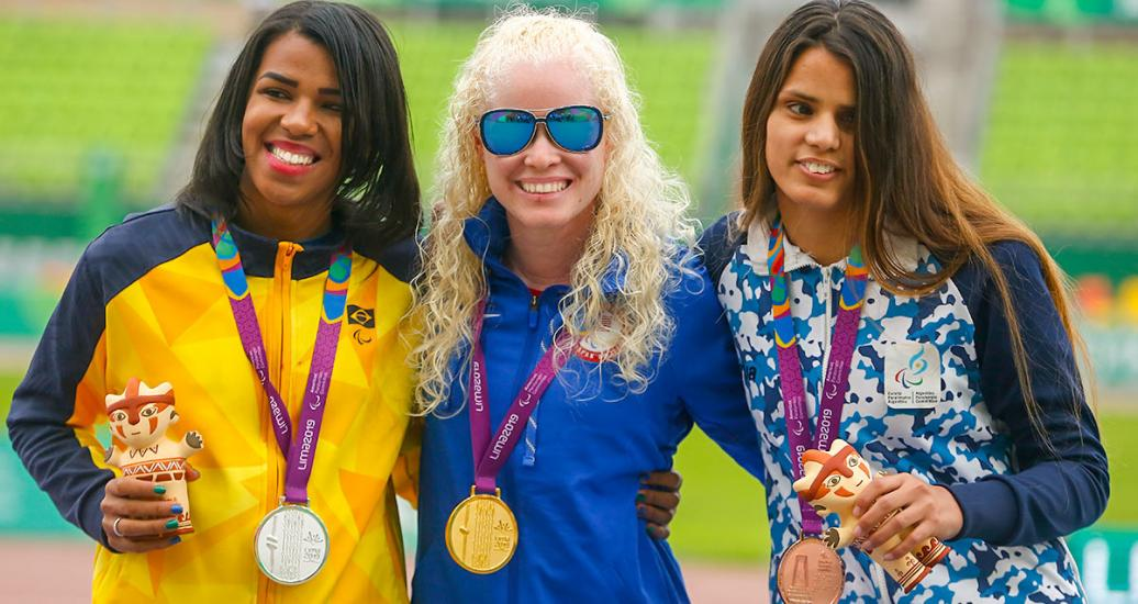 Brazilian Rayane Soares Da Silva (silver), Kimberly Crosby from USA (gold) and Argentinian Bianca Candela Cerrudo (bronze) showing their medals in the women's 100 m T13 event at the National Sports Village – VIDENA, Lima 2019