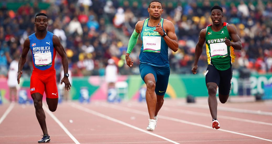 Dominican Mayovanex de Oleo, Brazilian Rodrigo Pereira and Guyanese Emanuel Archibald compete in the men's 100 m semifinals at the Lima 2019 Games