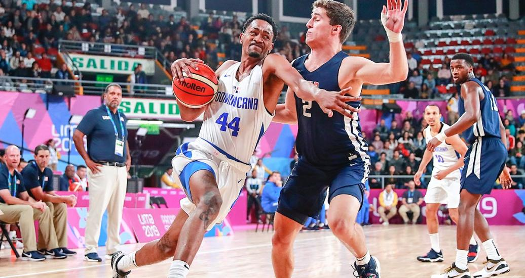 Luis Montero from Dominican Republic controls the ball in the Lima 2019 basketball game against the United States at the Eduardo Dibós Coliseum