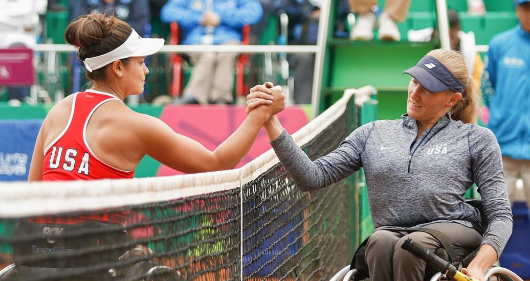 Dana Mathewson and Emmy Kaiser from the USA shake hands after Lima 2019 wheelchair tennis match at the Club Lawn Tennis