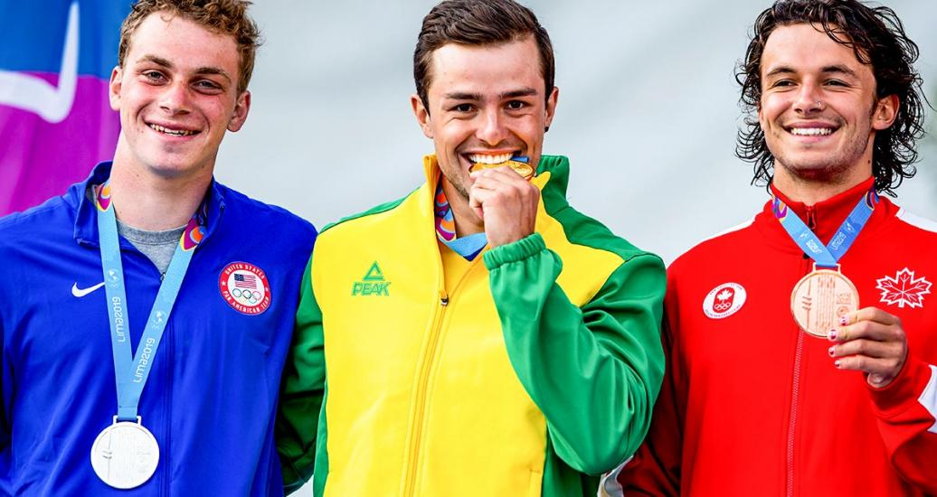 Canada's Keenan Simpson (bronze), US's Joshua Joseph (silver) and Brazil's Pedro Goncalves (gold) show the medals earned in the men's K1 extreme slalom in Río Cañete - Lunahuana