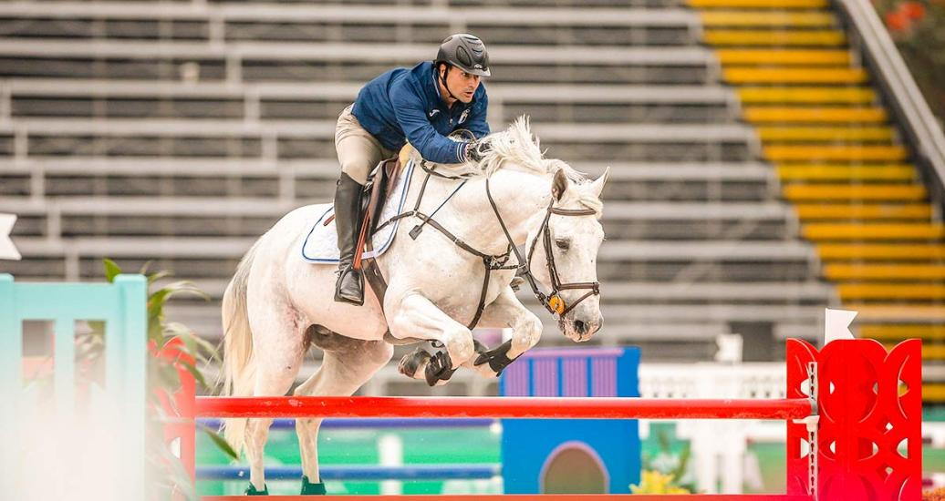 Guatemalan Juan Pablo Pivaral riding his horse during equestrian individual jumping training session at the Army Equestrian School