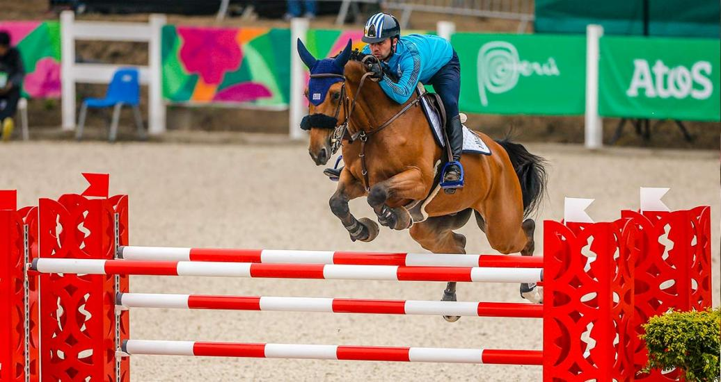 Uruguayan Marcelo Chirico riding his horse during equestrian individual jumping training session at the Army Equestrian School