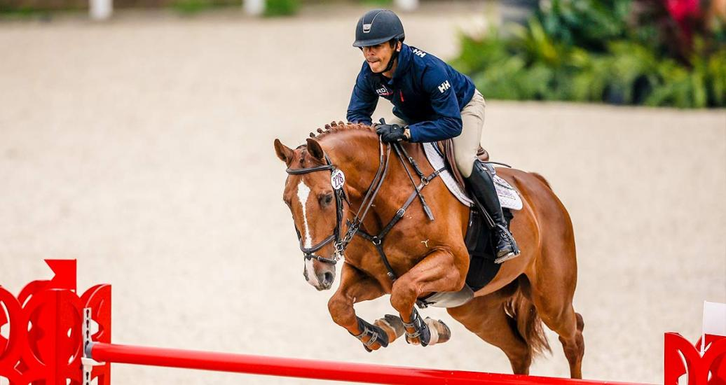 Héctor Florentino riding his horse during equestrian individual jumping training session at the Army Equestrian School