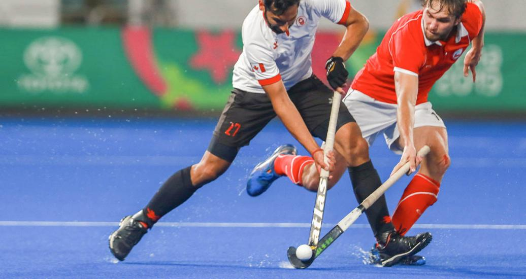 Singh Panesar from Canada faces Chilean Felipe Renz during the hockey semifinal at the Villa María del Triunfo Sports Center, Lima 2019 Games