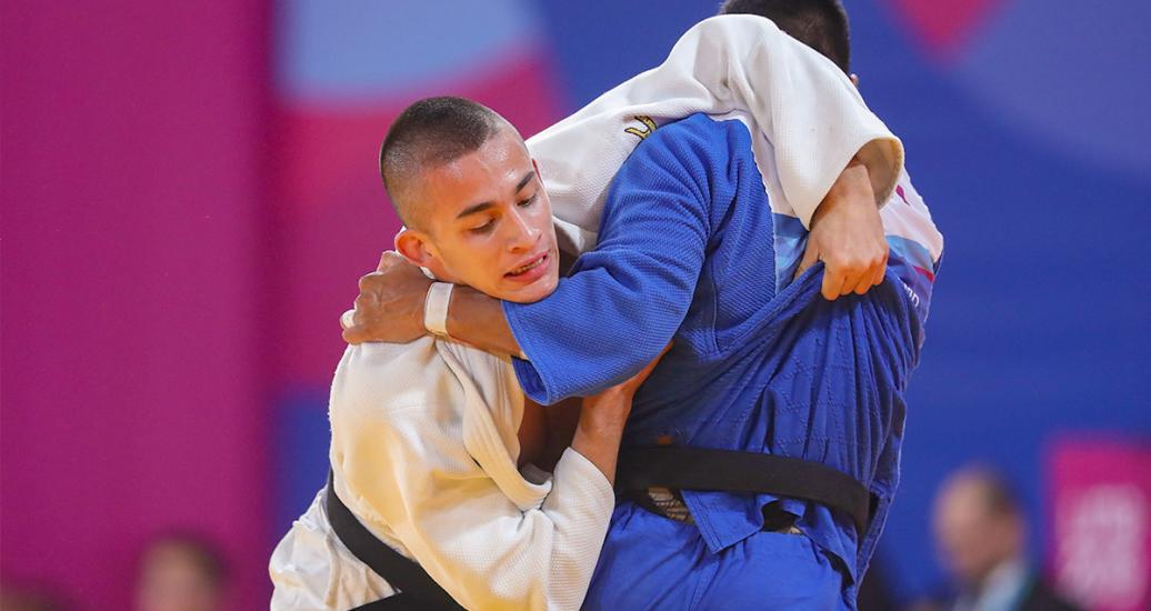 Colombian judoka Jorge Gonzales goes up against Peruvian Juan Postigos in the Lima 2019 men's -66 kg competition at the National Sports Village – VIDENA