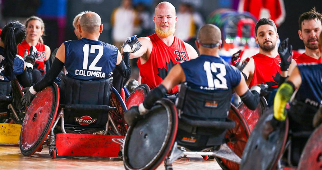 Canadian Zachary Madell shaking hands Esneider Cardenas from Colombia after the mixed wheelchair rugby match at the Villa El Salvador Sports Center, Lima 2019