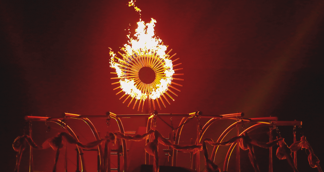 Acrobats jumping through the air around the Flame during an artistic performance at the Lima 2019 Parapan American Games Opening Ceremony at the National Stadium.