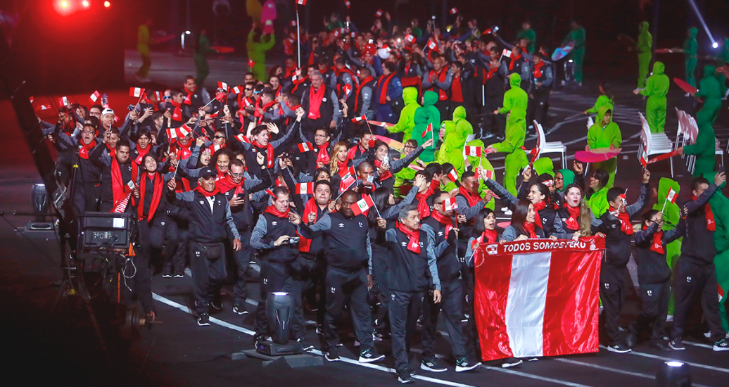 Peruvian delegation walks in carrying the national flag at the Lima 2019 Parapan American Games Opening Ceremony at the National Stadium.