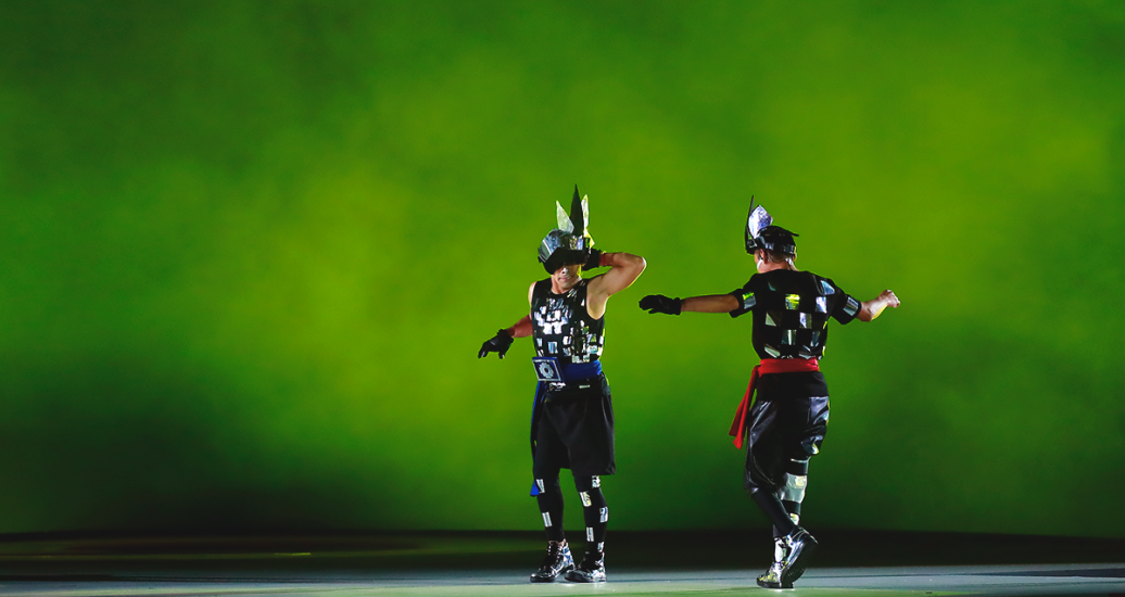 Two artists on the stage draw the attention of the public at the Lima 2019 Parapan American Games Opening Ceremony at the National Stadium.