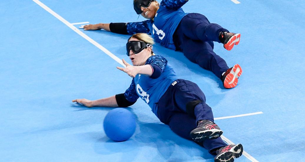 Ana Custodio and Gabrielly Assuncao from Brazil dive to catch the ball in the Lima 2019 goalball match against Mexico at the Callao Regional Sports Village